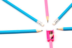 Color pencils and pencil sharpener. Lying  on a white background Royalty Free Stock Images