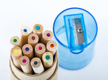 Color pencils and pencil sharpener. On white background Royalty Free Stock Images