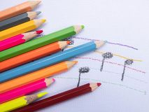 Color pencils place on white paper background with Music note drawing. Education concept. Color pencils place on white paper background with Music note drawing stock image