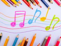 Color pencils place on white paper background with Music note drawing. Education concept. Color pencils place on white paper background with Music note drawing royalty free stock photos