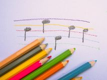 Color pencils place on white paper background with Music note drawing. Education concept. Color pencils place on white paper background with Music note drawing stock photos