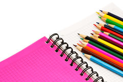 Color pencils and pocket-book Stock Images