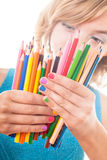 Color pencils. Color rainbow pencils and teenager's hands with multicoloured nails Royalty Free Stock Photo