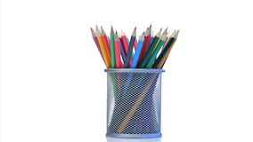 Color pencils rotating  in a pencil holder stock footage