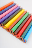 Color pencils in a row Royalty Free Stock Photos