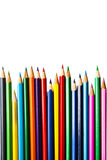 Color pencils row on white background; education equipment Royalty Free Stock Photo