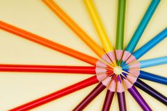 Color pencils in a row on yellow background. Stock Image
