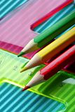 Color pencils on a rulers background stock photography