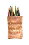 Color pencils in rusty tin can. On white Royalty Free Stock Photos