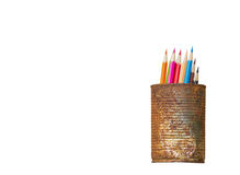 Color pencils in rusty tin can on white. Background Royalty Free Stock Images