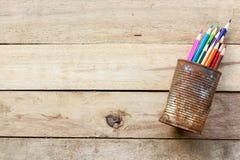 Color pencils in rusty tin can Stock Photos