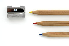 Color pencils with sharpener. Three wooden color pencils with sharpener on white background Stock Photo