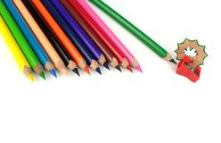 Color pencils and sharpener. On white background Stock Photo