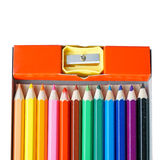 Color pencils with a sharpener Stock Photos