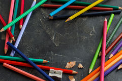 Color pencils  and sharpener Royalty Free Stock Photos