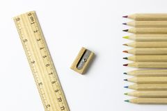 Color pencils, sharpener, ruler on white background. A colored pencil US-English, coloured pencil UK-English, Canada-English, pencil crayon Canada-English, lead Royalty Free Stock Photography