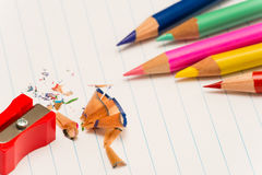Color pencils and sharpener shaving Royalty Free Stock Photo