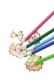 Color pencils and shavings. On white background with copy space Royalty Free Stock Photos