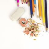 Color pencils, shavings and eraser Royalty Free Stock Photos