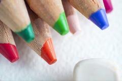 Color pencils shavings. On white paper Stock Photo