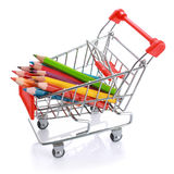 Color pencils in shopping cart isolated Royalty Free Stock Images