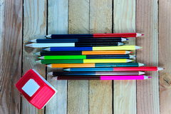 Color pencils and small house on wooden table see on top view Stock Images