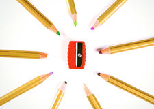 Color pencils. Some color pencils in isolated space  with Pencil sharpener Royalty Free Stock Image