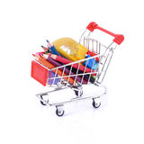 Color pencils and some stationery in shopping cart stock images