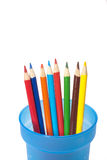 Color pencils spread out in cup. Royalty Free Stock Image