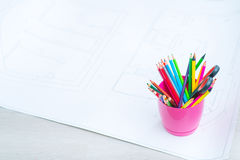 Color pencils standing on the floor Royalty Free Stock Photography