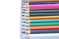 Color pencils in steel box royalty free stock photos