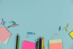Color pencils, sticky notes, and paper pins Royalty Free Stock Image