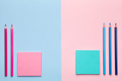 Color Pencils with Sticky Notes on Pastel Background. Pink and blue pencils with sticky notes on pastel background. Minimal style. Flat lay. Copy space. Top view Royalty Free Stock Images