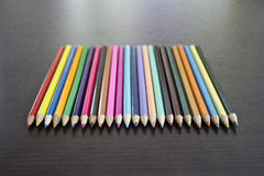 Color Pencils on the Table in a Row royalty free stock image