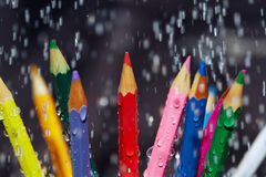 Color pencils under the rain Royalty Free Stock Photo