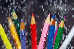 Color pencils under the rain Stock Photos