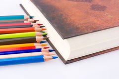 Color pencils of various colors near the Holy Quran Stock Photography