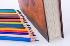 Color pencils of various colors near the Holy Quran. On a white background Royalty Free Stock Image