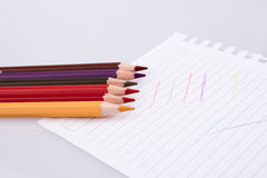 color pencils of various colors on a sheet of paper Royalty Free Stock Photo