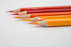Color pencils warm tone on white background Stock Photography