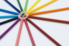 Color Pencils Arranged in Circle in Perspective View. Color pencils  on white arranged in circle. Perspective shot Royalty Free Stock Photos