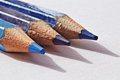 Color pencils on a white background. Blue color pencils on a white background, macro and closeup photography royalty free stock image