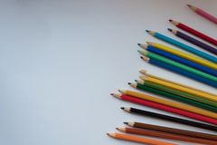 Color pencils on white background, copy space royalty free stock photos