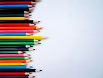 Color pencils on white background. Flat lay, top view, copy space royalty free stock photo