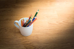 Color pencils in white coffee cup Royalty Free Stock Photography