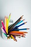 Color Pencils in a white mug. Sharp multi color pencils in a white mug and a white  background Stock Image