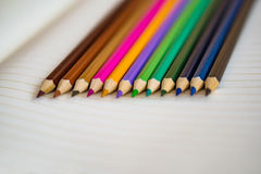 Color pencils on white notebook background.Close up.Concept scoo Royalty Free Stock Photos