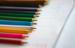 Color pencils on white notebook background.Close up.Concept scool Royalty Free Stock Photo