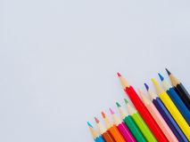 Color pencils on white paper Royalty Free Stock Image