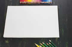 Color pencils and white paper Royalty Free Stock Photography